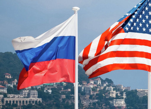 US Russia flags - Econ Alerts