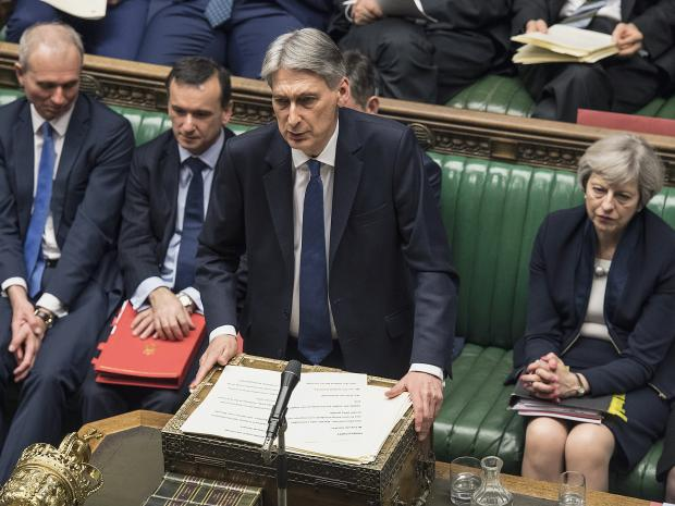 UK Chancellor in Parliament during UK Budget statement.