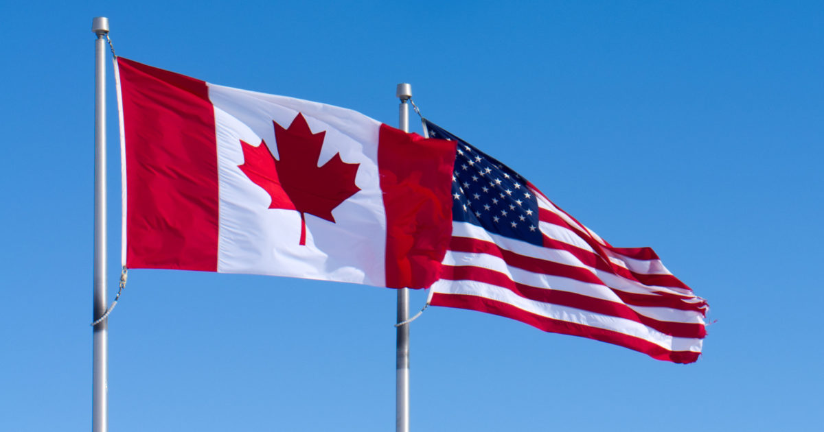 USA and Canada Flags - Econ Alerts