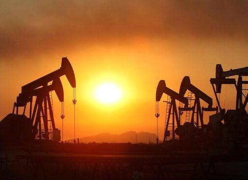 oil rigs smoke sunset california | EconAlerts