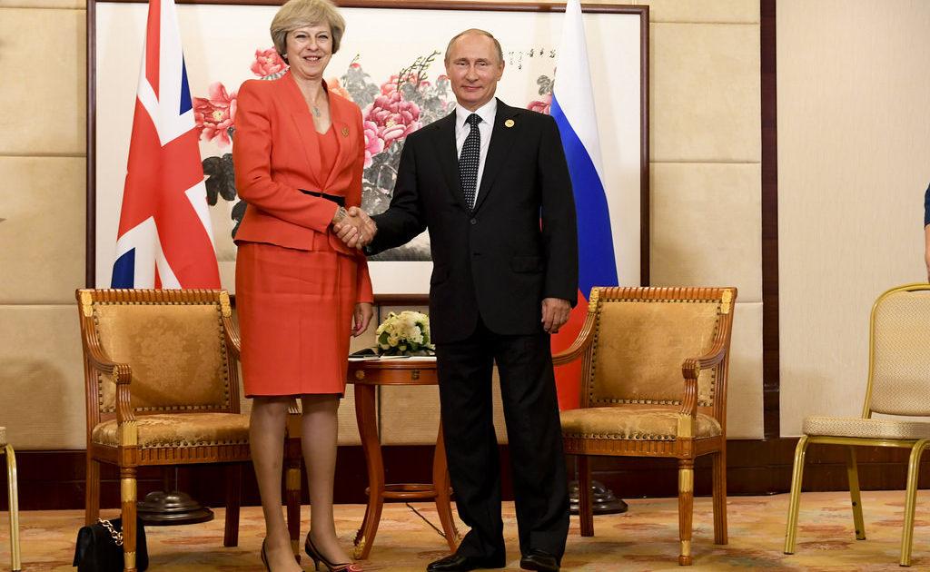 Theresa May and Vladimir Putin | EconAlerts