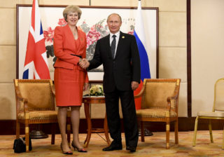 Theresa May and Vladimir Putin | EconAlerts