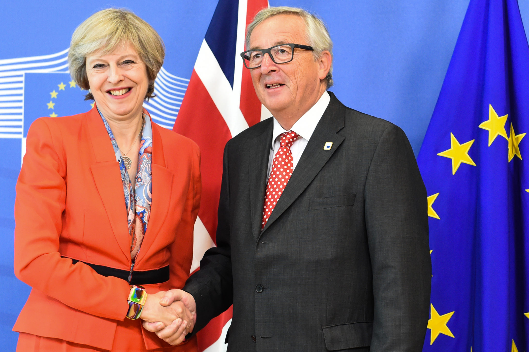 Theresa May, Jean-Claude Juncker | EconAlerts