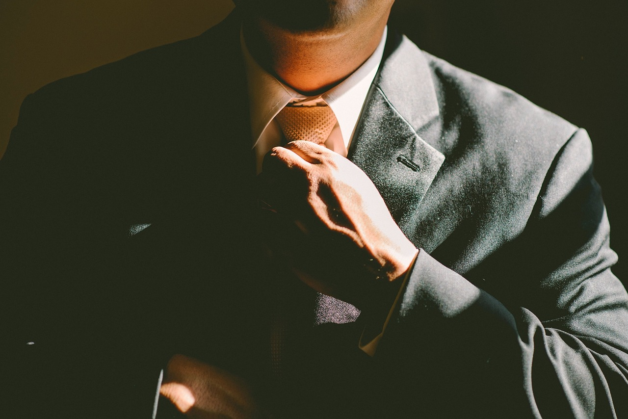 suit and neck tie | EconAlerts